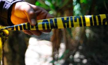 Hallan dos cadáveres dentro de costales en carretera a Olancho (Video)