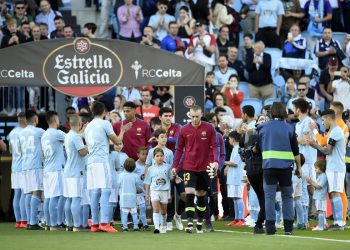 "Barcelona players, new champions of La Liga, walk through a passageway formed by Celta de Vigo players before the Spanish league football match between RC Celta de Vigo and FC Barcelona at the Balaidos stadium in Vigo on May 4, 2019. (Photo by Miguel RIOPA / AFP) / ""The erroneous byline appearing in the metadata of this photo by MIGUEL RIOPA has been modified in AFP systems in the following manner: [Miguel Riopa] instead of [Oscar Pozo]. Please immediately remove the erroneous mention[s] from all your online services and delete it (them) from your servers. If you have been authorized by AFP to distribute it (them) to third parties, please ensure that the same actions are carried out by them. Failure to promptly comply with these instructions will entail liability on your part for any continued or post notification usage. Therefore we thank you very much for all your attention and prompt action. We are sorry for the inconvenience this notification may cause and remain at your disposal for any further information you may require."""