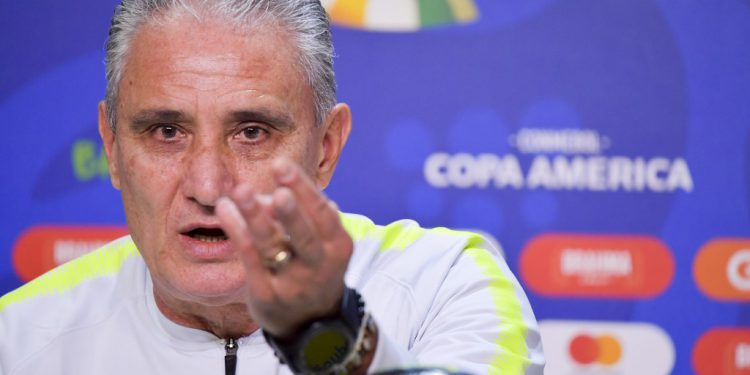Brazil's coach Tite gestures during a press conference in Porto Alegre, Brazil, on June 26, 2019, on the eve of the Copa America quarterfinal football match against Paraguay. (Photo by Luis Acosta / AFP)