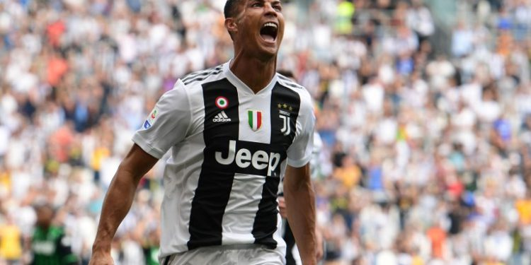 Juventus' Portuguese forward Cristiano Ronaldo celebrates after he scored his first goal since he joined Juventus during the Italian Serie A football match Juventus vs Sassuolo on September 16, 2018 at the Juventus stadium in Turin. / AFP PHOTO / Miguel MEDINA