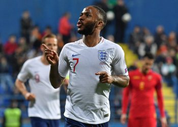 England's forward Raheem Sterling celebrates after scoring the fifth goals of his team during the Euro 2020 football qualification match between Montenegro and England at Podgorica City Stadium on March 25, 2019 in Podgorica, Montenegro. (Photo by Andrej ISAKOVIC / AFP)