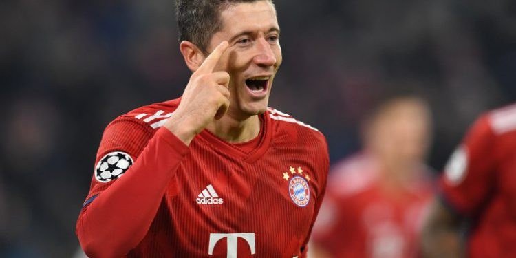 Bayern Munich's Polish forward Robert Lewandowski celebrates after scoring the 4-1 goal during the UEFA Champions League Group E football match between Bayern Munich and Benfica Lisbon in Munich, southern Germany, on November 27, 2018. (Photo by Christof STACHE / AFP)