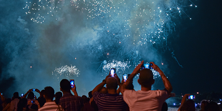 People watch the fireworks during the celebration of the 500 anniversary of Havana, Cuba's capital city on November 15, 2019. (Photo by Adalberto ROQUE / AFP)