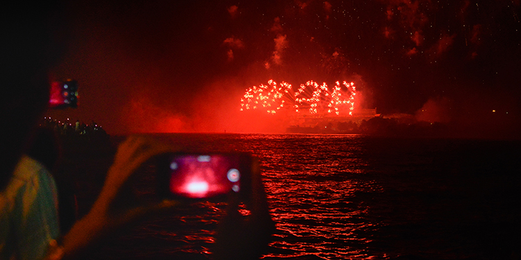 People watch the fireworks during the celebration of the 500 anniversary of Havana, Cuba's capital city on November 15, 2019. (Photo by ANA RODRIGUEZ / AFP)