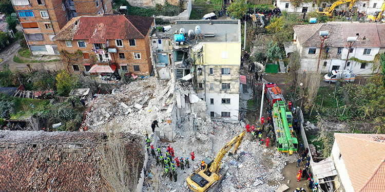 This aerial photo taken on November 27, 2019 shows emergency workers during an operation at a collapsed building in Thumane, northwest of capital Tirana, after an earthquake hit Albania. - Albania was in national mourning on November 27 as emergency workers continued to pull bodies from the ruins of buildings gutted by a violent earthquake, with nearly 30 dead found so far and more than 40 rescued alive. Tirana declared a state of emergency in the areas hardest-hit by the November 26 pre-dawn earthquake: the coastal city of Durres and the town of Thumane, where victims were trapped by toppled buildings. (Photo by Gent SHKULLAKU / AFP)