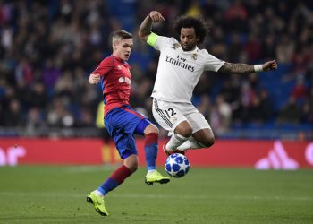 CSKA Moscow's Icelandic midfielder Arnor Sigurdsson (L) vies with Real Madrid's Brazilian defender Marcelo during the UEFA Champions League group G football match between Real Madrid CF and CSKA Moscow at the Santiago Bernabeu stadium in Madrid on December 12, 2018. (Photo by JAVIER SORIANO / AFP)