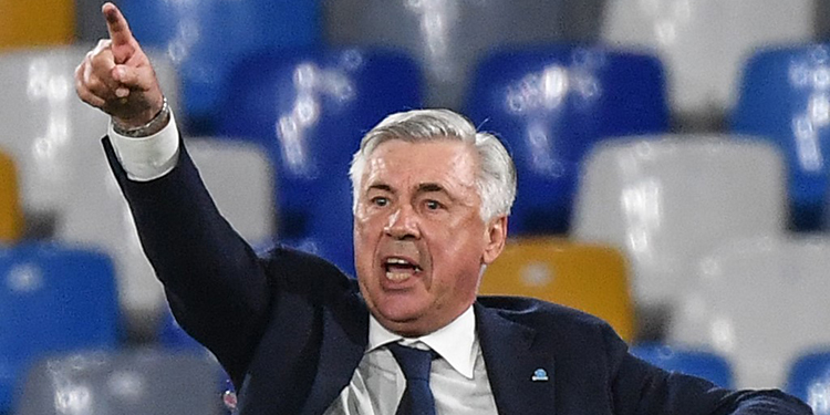 (FILES) In this file photo taken on September 25, 2019 Napoli's Italian head coach Carlo Ancelotti gestures as he shouts instructions during the Italian Serie A football match Napoli vs Cagliari at the San Paolo stadium in Naples. - Carlo Ancelotti has been named as Everton's new manager, the Premier League club have announced on December 21, 2019. (Photo by Andreas SOLARO / AFP)