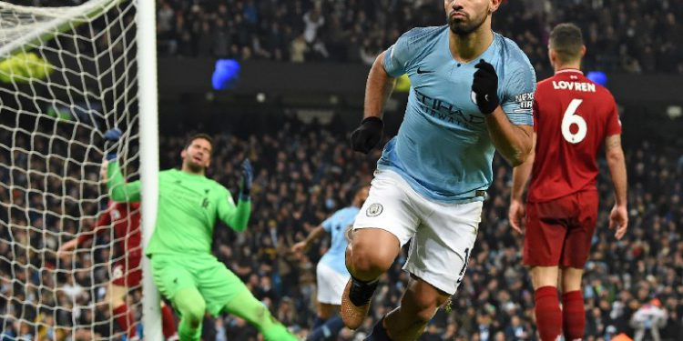 Liverpool's Brazilian goalkeeper Alisson Becker (L) reacts as Manchester City's Argentinian striker Sergio Aguero celebrates after scoring the opening goal of the English Premier League football match between Manchester City and Liverpool at the Etihad Stadium in Manchester, north west England, on January 3, 2019. (Photo by Paul ELLIS / AFP) / RESTRICTED TO EDITORIAL USE. No use with unauthorized audio, video, data, fixture lists, club/league logos or 'live' services. Online in-match use limited to 120 images. An additional 40 images may be used in extra time. No video emulation. Social media in-match use limited to 120 images. An additional 40 images may be used in extra time. No use in betting publications, games or single club/league/player publications. /