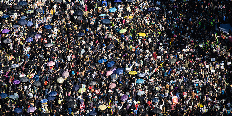 """People gather at Victoria Park for a pro-democracy rally in Hong Kong on December 8, 2019. - Vast crowds of democracy protesters thronged Hong Kong's streets on December 8 in a forceful display of support for the movement on its six-month anniversary, as organisers warned the city's pro-Beijing leaders they had a """"last chance"""" to end the political crisis. (Photo by ANTHONY WALLACE / AFP)"""