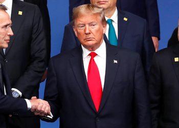 Donald Trump (centro), y Recep Tayyip Erdogan (derecha).