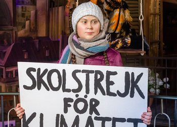 "A picture taken on January 29, 2020 shows a detail of a wax figure bearing Swedish teen climate activist Greta Thunberg with a placard reading ""the school strike for the climate"" (in Swedish Skolstrejk för klimatet) during its presentation at the Panoptikum waxworks museum in Hamburg, northern Germany. (Photo by Markus Scholz / dpa / AFP) / Germany OUT"