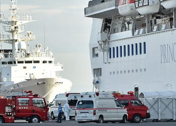Personnel clad in protective gear and tasked to provide care for suspected patients on board the Diamond Princess cruise ship prepare to conduct a transfer at the Daikoku Pier Cruise Terminal in Yokohama on February 7, 2020, as over 3,700 people remain quarantined onboard due to fears of the new coronavirus. - At least 61 people on board a cruise ship off Japan have tested positive for the new coronavirus, the government said February 7, as thousands of passengers and crew face a two-week quarantine. (Photo by Kazuhiro NOGI / AFP)