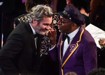 US actor Joaquin Phoenix (L) and US director Spike Lee chat ahead of the 62nd Annual Grammy Awards on January 26, 2020, in Los Angeles. (Photo by Robyn BECK / AFP)
