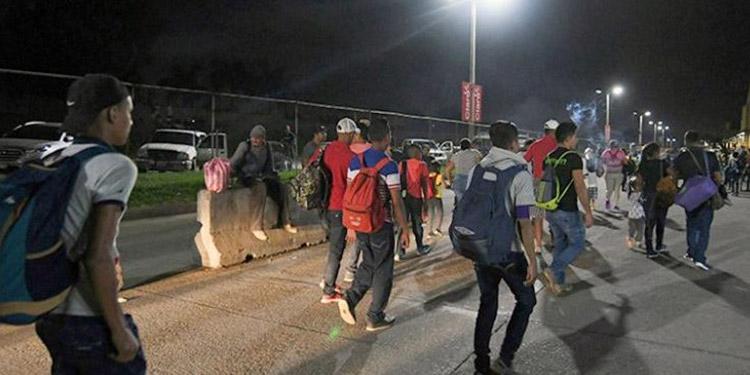 A los migrantes hondureños de la caravana que tengan síntomas de coronavirus no se les dejará ingresar a Guatemala.
