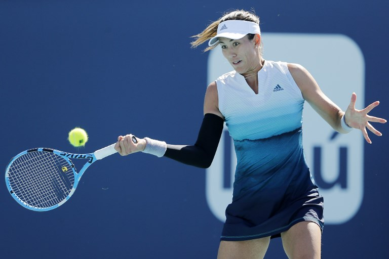 MIAMI GARDENS, FLORIDA - MARCH 22: Garbine Muguruza of Spain returns a shot to Monica Niculescu of Romania during Day 5 of the Miami Open Presented by Itau at Hard Rock Stadium on March 22, 2019 in Miami Gardens, Florida.   Michael Reaves/Getty Images/AFP