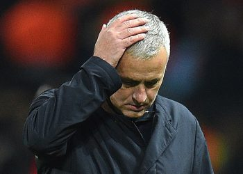(FILES) In this file photo taken on November 27, 2018 Manchester United's Portuguese manager Jose Mourinho leaves the pitch following the UEFA Champions League group H football match between Manchester United and Young Boys at Old Trafford in Manchester, north-west England. - Manchester United have sacked manager Jose Mourinho after a dreadful series of results, the Premier League club announced on December 18, 2018. The 55-year-old Portuguese's last match in charge was the 3-1 defeat by league leaders Liverpool on Sunday which left them 19 points behind their opponents. (Photo by Oli SCARFF / AFP)