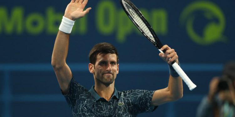Serbia's Novak Djokovic celebrates after winning against Bosnia and Herzegovina's Damir Dzumhur during the ATP Qatar Open tennis competition's first round in Doha on January 1, 2019. (Photo by Karim JAAFAR / AFP)