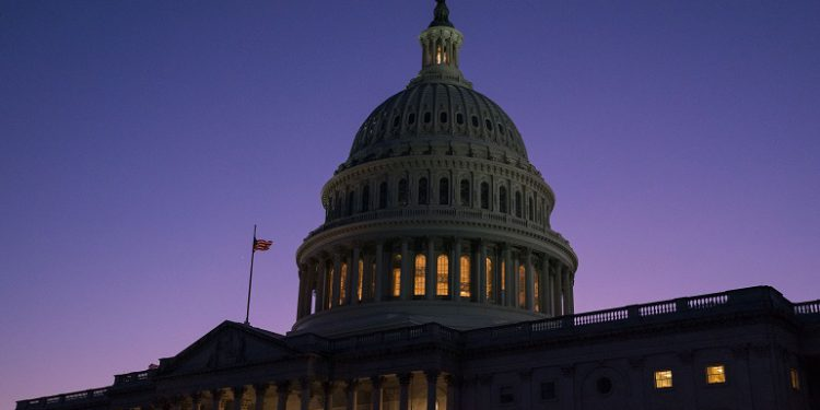 WASHINGTON, DC - DECEMBER 18: The US Capitol is seen at sunset as members of the House of Representatives debate charging President Donald Trump with two articles of impeachment including abuse of power and obstruction of Congress on December 18, 2019 in Washington, DC.   Sarah Silbiger/Getty Images/AFP