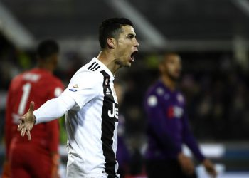 Juventus's striker Cristiano Ronaldo from Portugal celebrates after scoring a penalty kick during the Serie A football match Fiorentina versus Juventus on December 1, 2018, at the Artemio Franchi Stadium in Florence. (Photo by Filippo MONTEFORTE / AFP)