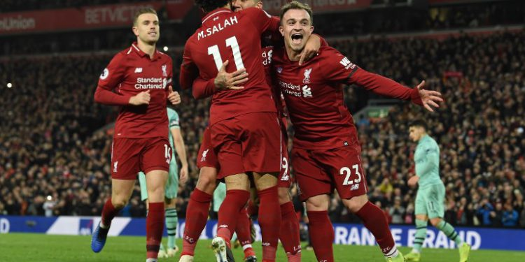 Liverpool's Brazilian midfielder Roberto Firmino (2R) celebrates shooting from the penalty spot to score his team's fifth goal during the English Premier League football match between Liverpool and Arsenal at Anfield in Liverpool, north west England on December 29, 2018. (Photo by Paul ELLIS / AFP) / RESTRICTED TO EDITORIAL USE. No use with unauthorized audio, video, data, fixture lists, club/league logos or 'live' services. Online in-match use limited to 120 images. An additional 40 images may be used in extra time. No video emulation. Social media in-match use limited to 120 images. An additional 40 images may be used in extra time. No use in betting publications, games or single club/league/player publications. /