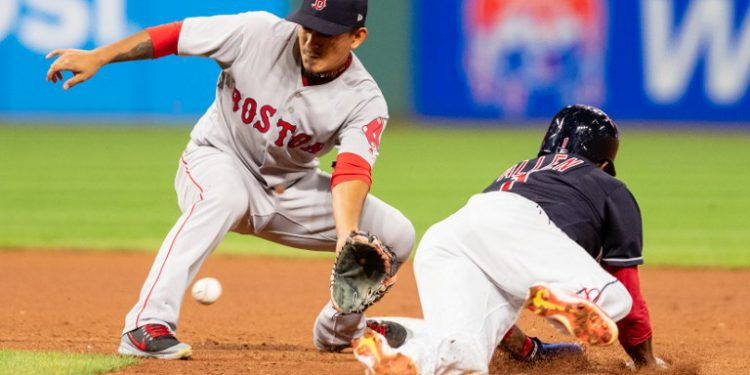 CLEVELAND, OH - SEPTEMBER 23: Shortstop Tzu-Wei Lin #30 of the Boston Red Sox tags out Greg Allen #1 of the Cleveland Indians on a steal attempt to end the seventh inning at Progressive Field on September 23, 2018 in Cleveland, Ohio.   Jason Miller/Getty Images/AFP