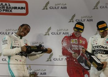 Mercedes' Finnish driver Valtteri Bottas (1st-L, second placed), Mercedes' British driver Lewis Hamilton (2nd-R, first placed) and Ferrari's Monegasque driver Charles Leclerc (1st-R, third placed) celebrate on the podium after the Formula One Bahrain Grand Prix at the Sakhir circuit in the desert south of the Bahraini capital Manama, on March 31, 2019. (Photo by KARIM SAHIB / AFP)