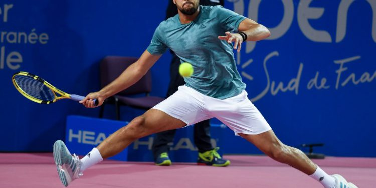 France's Jo-Wilfried Tsonga returns the ball to Latvia's Radu Albot during their semi-final tennis match at the Open Sud de France ATP World Tour in Montpellier, southern France, on February 9, 2019. (Photo by PASCAL GUYOT / AFP)