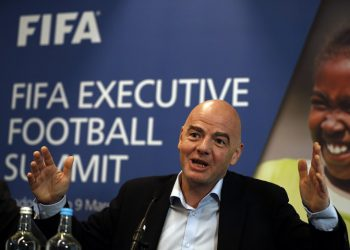 FIFA President Gianni Infantino gestures while talking with journalists during a press conference following the FIFA Executive Football Summit near Heathrow airport in London on March 9, 2017.  Barcelona's extraordinary fightback to beat Paris Saint-Germain in the Champions League demonstrated football's unique capacity for surprise, FIFA president Gianni Infantino said. / AFP PHOTO / ADRIAN DENNIS