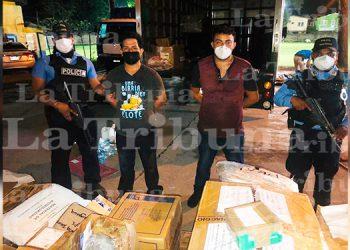 Capturan a dos hombres con mercadería robada a empresa de mensajería