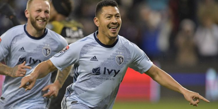 US Sporting KC players Roger Espinoza (R) and Johnny Russell celebrate after scoring against Panama's Club Atletico Independiente during their Concacaf Champions League quarterfinal game at Children's Mercy Park on March 14, 2019. - Sporting KC defeated Club Atletico Independiente 3-0 (Photo by Tim Vizer / AFP)