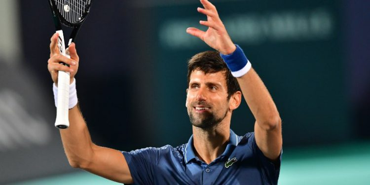 Novak Djokovic of Serbia reacts after winning his  the 2018 Mubadala World Tennis Championship second semi-final match against Karen Khachanov of Russia, in Abu Dhabi on December 28, 2018. (Photo by GIUSEPPE CACACE / AFP)