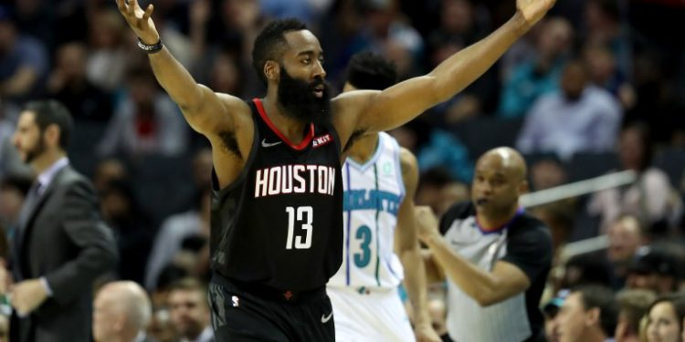 (FILES) In this file photo taken on February 26, 2019 James Harden #13 of the Houston Rockets reacts after a play against the Charlotte Hornets during their game at Spectrum Center in Charlotte, North Carolina. - James Harden scored 27 points in the first quarter and matched his career best of 61 as the Houston Rockets rallied late to beat the San Antonio Spurs 111-105 on Friday. The 29-year-old NBA scoring leader equalled his career-high total which he set earlier this season at Madison Square Garden and scored more than 50 points for the eighth time this season. (Photo by Streeter LECKA / GETTY IMAGES NORTH AMERICA / AFP)