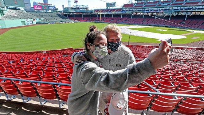 BOSTON MA. - OCTOBER 17:  Mother and daughter Abby Hernois (L) and Chris Healey take a selfie after voting as Early Voting begins at Fenway Park, on October 17, 2020 in Boston, MA. (Staff Photo By Stuart Cahill/MediaNews Group/Boston Herald)