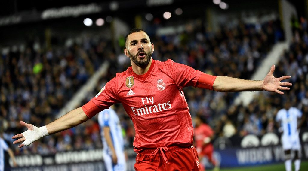 Real Madrid's French forward Karim Benzema celebrates after scoring during the Spanish league football match between Club Deportivo Leganes SAD and Real Madrid CF at the Estadio Municipal Butarque in Leganes on April 15, 2019. (Photo by PIERRE-PHILIPPE MARCOU / AFP)