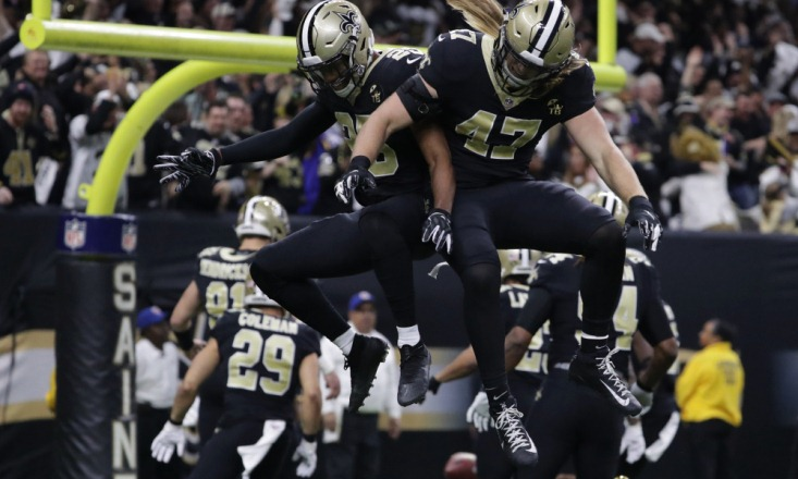 Jan 20, 2019; New Orleans, LA, USA; New Orleans Saints cornerback Eli Apple (25) and middle linebacker Alex Anzalone (47) celebrate after a turnover against the Los Angeles Rams during the first quarter of the NFC Championship game at Mercedes-Benz Superdome. Mandatory Credit: Derick E. Hingle-USA TODAY Sports