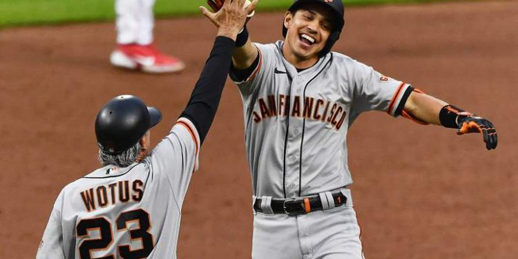 CINCINNATI, OH - MAY 17: Mauricio Dubón #1 of the San Francisco Giants celebrates his solo home run in sixth inning against the Cincinnati Reds with third base coach Ron Wotus #23 at Great American Ball Park on May 17, 2021 in Cincinnati, Ohio.   Jamie Sabau/Getty Images/AFP (Photo by Jamie Sabau / GETTY IMAGES NORTH AMERICA / Getty Images via AFP)