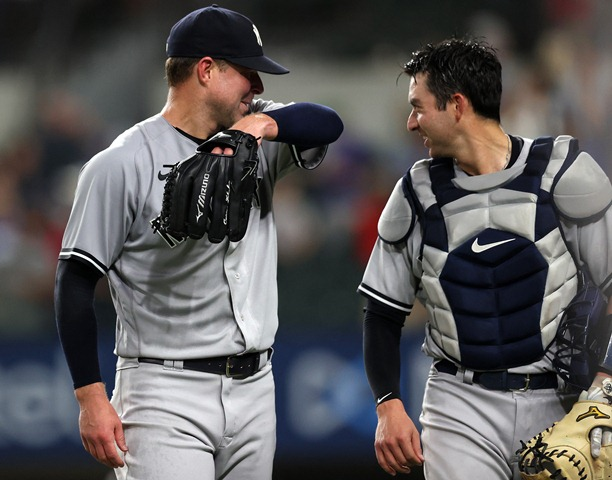 ARLINGTON, TEXAS - MAY 19: Corey Kluber #28 of the New York Yankees celebrates a no-hitter with Kyle Higashioka #66 against the Texas Rangers at Globe Life Field on May 19, 2021 in Arlington, Texas.   Ronald Martinez/Getty Images/AFP (Photo by RONALD MARTINEZ / GETTY IMAGES NORTH AMERICA / Getty Images via AFP)