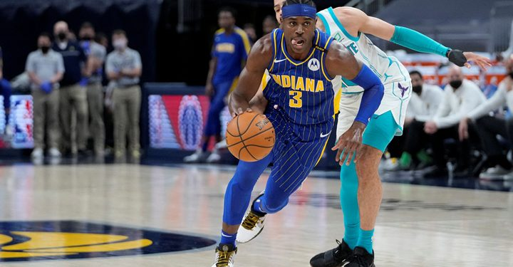 INDIANAPOLIS, IN - MAY 18: Aaron Holiday #3 of the Indiana Pacers drives to the basket against the Charlotte Hornets during the 2021 NBA Play-In Tournament on May 18, 2021 at Bankers Life Fieldhouse in Indianapolis, Indiana. NOTE TO USER: User expressly acknowledges and agrees that, by downloading and or using this Photograph, user is consenting to the terms and conditions of the Getty Images License Agreement. Mandatory Copyright Notice: Copyright 2021 NBAE   A.J. Mast/NBAE via Getty Images/AFP (Photo by A.J. Mast / NBAE / Getty Images / Getty Images via AFP)