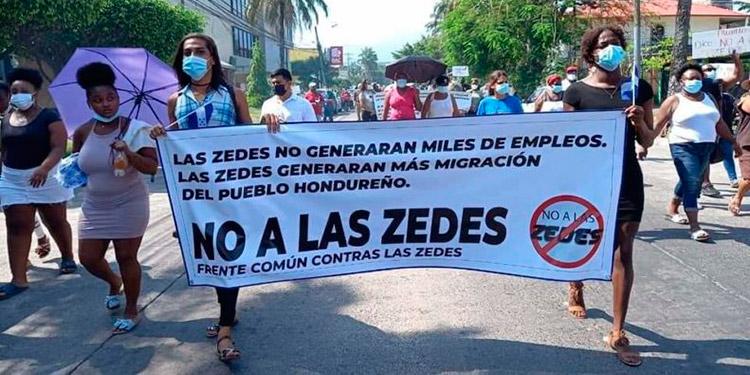 La agitación interna por las ZEDE contrasta con el silencio de los organismos multilaterales de crédito.