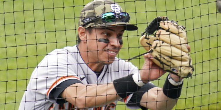 San Francisco Giants second baseman Mauricio Dubon catches a foul ball by Pittsburgh Pirates' Kevin Newman in the fifth inning of a baseball game, Sunday, May 16, 2021, in Pittsburgh. (AP Photo/Keith Srakocic)