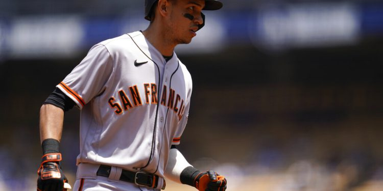 San Francisco Giants' Mauricio Dubon (1) runs the bases after hitting a home run during the first inning of a baseball game against the Los Angeles Dodgers Sunday, May 30, 2021, in Los Angeles. Donovan Solano also scored. (AP Photo/Ashley Landis)
