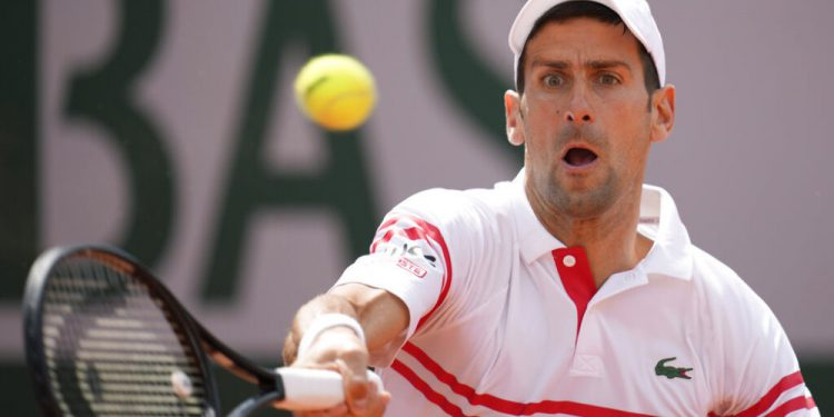 Serbia's Novak Djokovic plays a return to Uruguay's Pablo Cuevas during their second round match on day 5, of the French Open tennis tournament at Roland Garros in Paris, France, Thursday, June 3, 2021. (AP Photo/Christophe Ena)