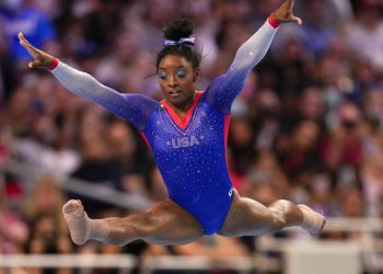 Simone Biles competes in the floor exercise during the women's U.S. Olympic Gymnastics Trials Friday, June 25, 2021, in St. Louis. (AP Photo/Jeff Roberson)