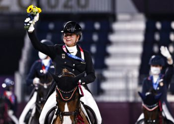 Gold medalist Isabell Werth of Germany rides on her horse together with other medalists after the medal ceremony of the Equestrian Dressage team final at Equestrian Park at Equestrian Park during the 2020 Summer Olympics, Tuesday, July 27, 2021, in Tokyo, Japan. (Alkis Konstantinidis/Pool Photo via AP)