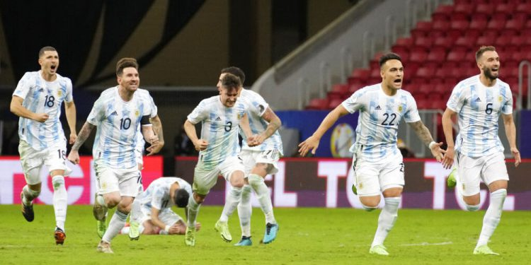 Players of Argentina celebrate defeating Colombia in a penalty shootout during a Copa America semifinal soccer match at the National stadium in Brasilia, Brazil, Wednesday, July 7, 2021. (AP Photo/Andre Penner)