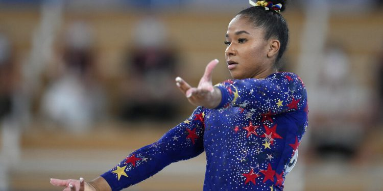 CORRECTS TO JORDAN CHILES FROM SUNISA LEE - Jordan Chiles, of the United States, performs on the floor during the women's artistic gymnastic qualifications at the 2020 Summer Olympics, Sunday, July 25, 2021, in Tokyo. (AP Photo/Natacha Pisarenko)