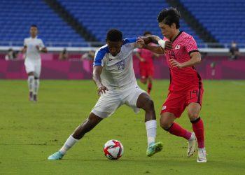 Honduras' Douglas Martinez, left, and South Korea's Kang Yoonseong compete for the ball during a men's soccer match at the 2020 Summer Olympics, Wednesday, July 28, 2021, in Yokohama. (AP Photo/Kiichiro Sato)