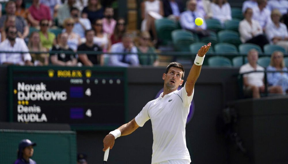 Serbia's Novak Djokovic serves to Denis Kudla of the US during the men's singles third round match on day five of the Wimbledon Tennis Championships in London, Friday July 2, 2021. (AP Photo/Alberto Pezzali)