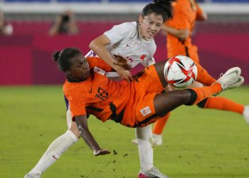 Netherlands' Lineth Beerensteyn (18) and China's Wang Yin battle for the ball during a women's soccer match against Netherlands at the 2020 Summer Olympics, Tuesday, July 27, 2021, in Yokohama, Japan. (AP Photo/Kiichiro Sato)