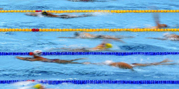 Nadadores durante un entrenamiento en Centro Acuático de los Juegos Olímpicos de Tokio, el miércoles 21 de julio de 2021. (AP Foto/Matthias Schrader)
